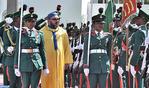 SM el Rey recibido con honores en Abuya